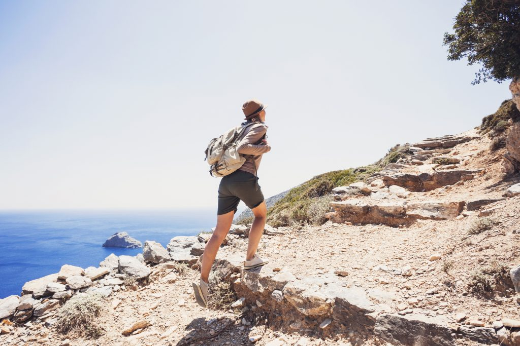 Young girl hiker on mountain trail